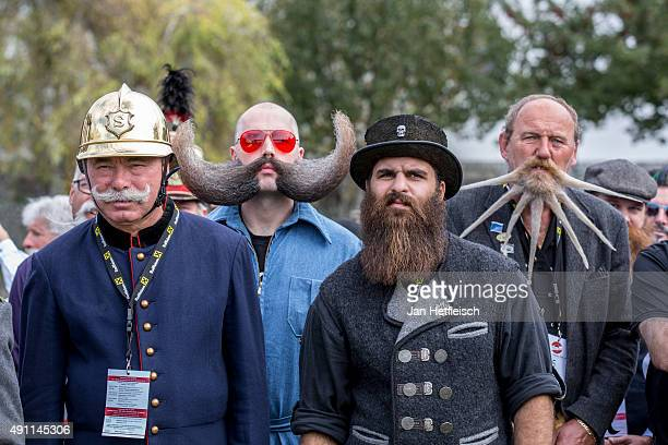 Contestants of the World Beard And Mustache Championships pose for a picture during the opening ceremony of the Championships 2015 on October 3 2015...