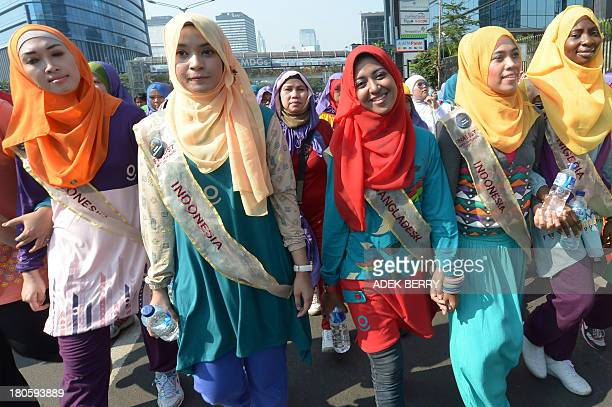 Contestants of the World Muslimah contest Nanzin Sultana Liza of Bangladesh Obabiyi Aishah of Nigeria and others from Indonesia take part in a fun...