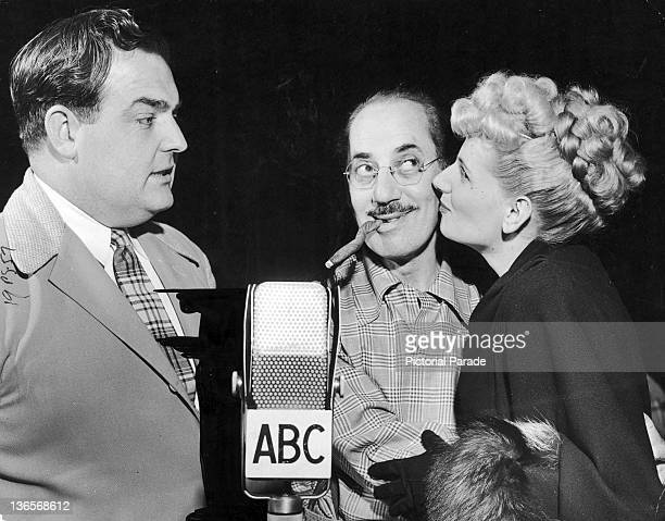 Contestants on the radio quiz show 'You Bet Your Life' with host Groucho Marx circa 1948