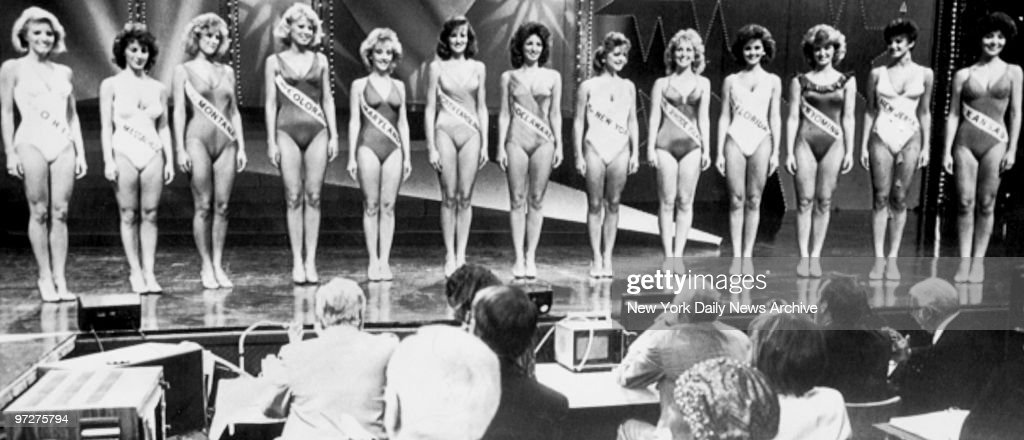 Contestants parade before the judges in their swimsuits duri : News Photo