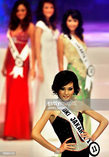 Contestants parade on the catwalk during the Miss Indonesia 2007 pageant in Jakarta 03 August 2007 Some 36 contestants from across Indonesia took...