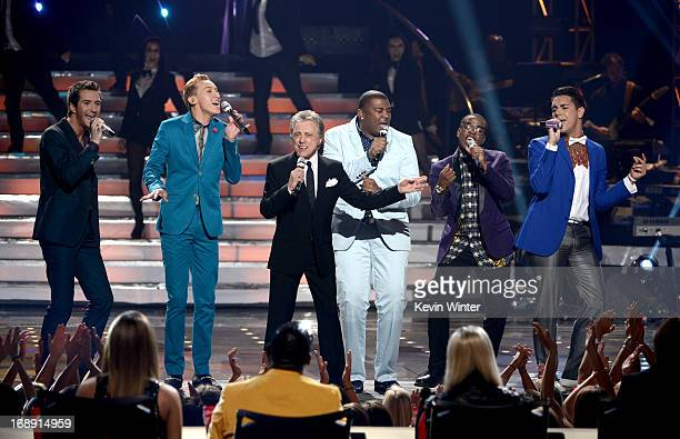 Contestants Paul Jolley Devin Velez singer Frankie Valli contestants Curtis Finch Jr Burnell Taylor and Lazaro Arbos perform onstage during Fox's...