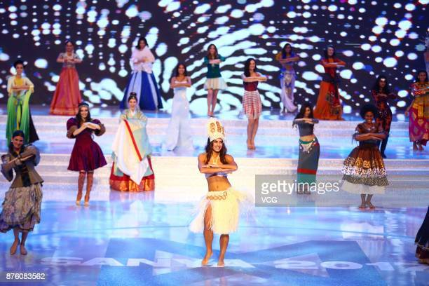 Contestants perform during the 67th Miss World final contest on November 18 2017 in Sanya Hainan Province of China