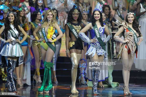 Contestants perform their opening number during the MIss Earth 2017 coronation night held at the Mall of Asia Arena in Pasay city south of Manila...