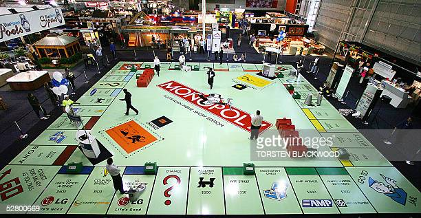 Contestants play the first game on the world's largest Monopoly board occupying an enormous 440 square metres at the Sydney Exhibition Centre to...