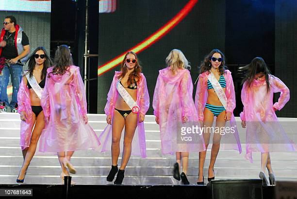 Contestants pose during the 37th Miss Tourism International Global Final at Zhanjiang Sports Center on December 17 2010 in Zhanjiang Guangdong...