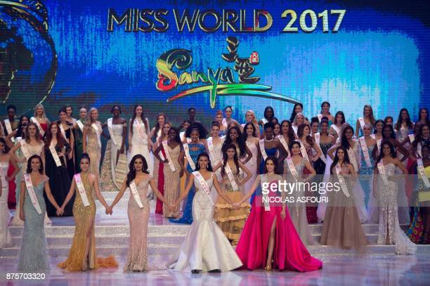 Contestants pose during the 67th Miss World contest final in Sanya on the tropical Chinese island of Hainan on November 18 2017 / AFP PHOTO / NICOLAS...