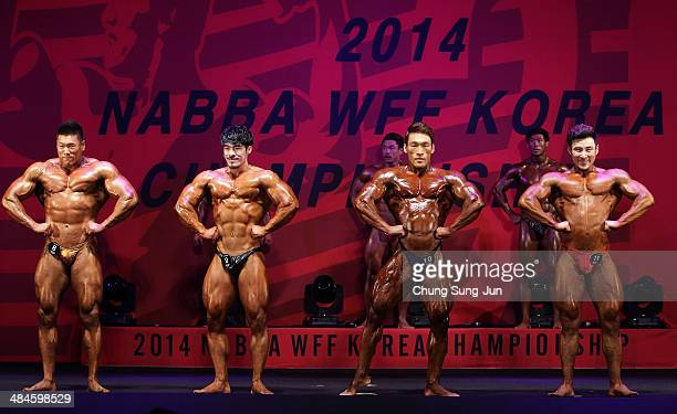 Contestants pose for judges in the WFF Men Class Three competition during the 2014 NABBA/WFF Korea Championship on April 13 2014 in Daegu South Korea