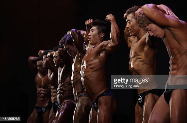 Contestants pose for judges in the WFF Men Class Two competition during the 2014 NABBA/WFF Korea Championship on April 13 2014 in Daegu South Korea