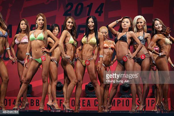 Contestants pose for judges in the WFF Miss Bikini competition during the 2014 NABBA/WFF Korea Championship on April 13 2014 in Daegu South Korea