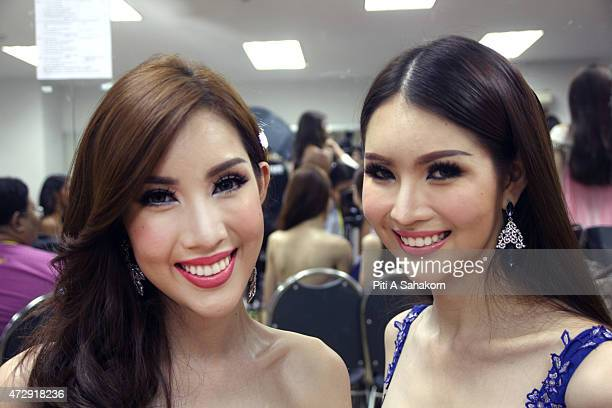 Contestants pose for photographs before the Miss Tiffany Universe contest in Pattaya which has been running for 18 years with all transsexual or...