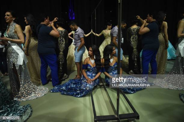 Contestants rest backstage during the Miss International Queen 2018 transgender beauty pageant in Pattaya on March 9 2018 / AFP PHOTO / LILLIAN...