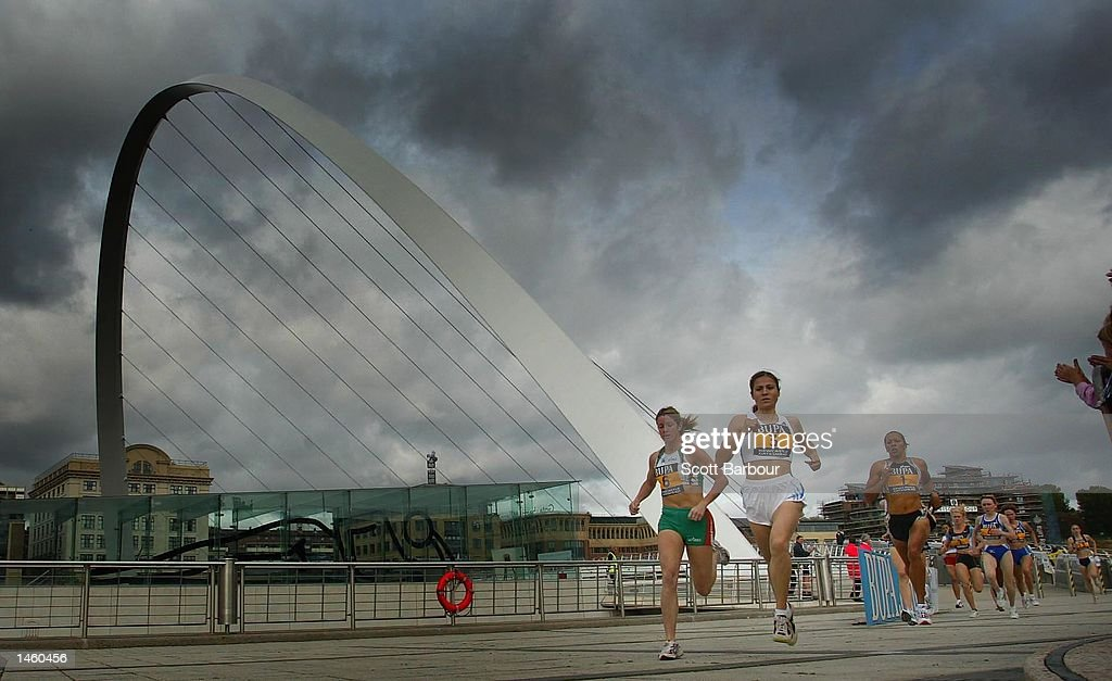 Contestants run past the Gatehead Millennium Bridge during the BUPA Great North Mile International Women's Race on October 5, 2002 in Newcastle, England.