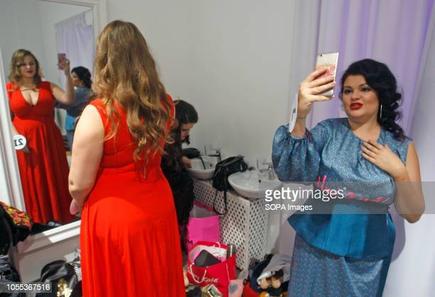 Contestants seen posing for selfies backstage during the Miss Ukraine Plus Size beauty pageant in Kiev 22 female contestants competed in the contest...
