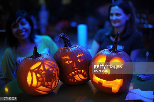 Contestants sit with their carved pumkin creations on October 27 2010 at the Helix Hotel in Washington DC The Helix Lounge's Pumpkin Carving Contest...