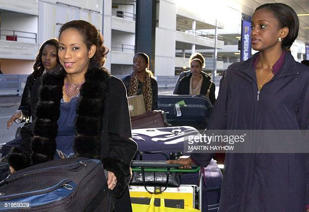 Contestants smile upon their arrival at Gatwick Airport 24 November 2002 Miss World contestants arrived in London on Sunday after the pageant pulled...