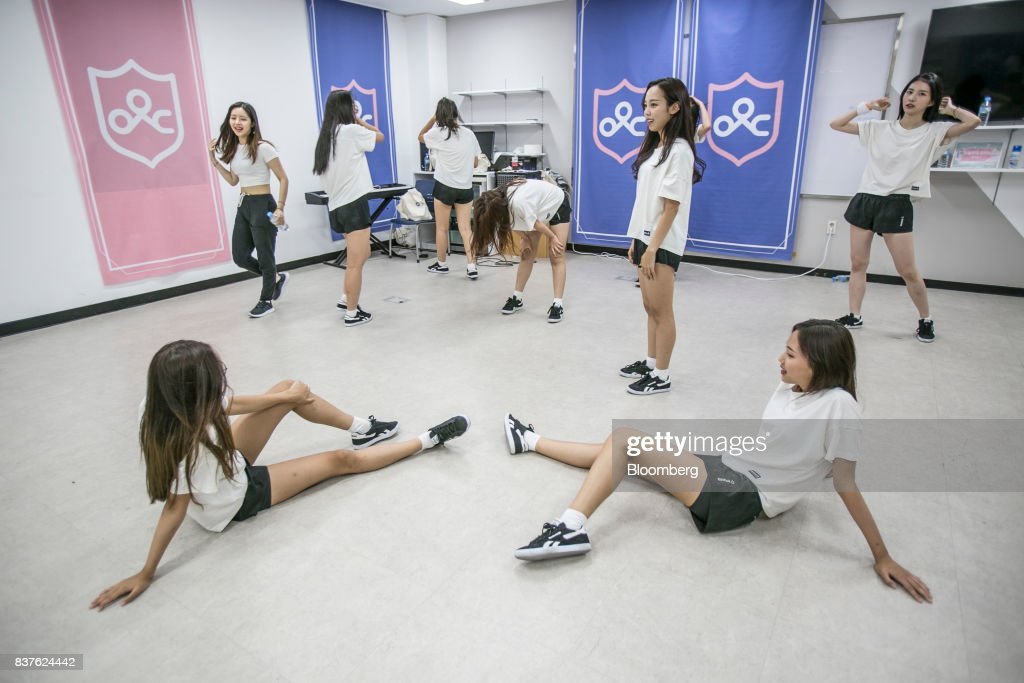 Contestants stretch during a dance practice session during the production of the 'Idol School' reality television show by CJ E&M Corp. at the Yangpyeong English School in Yangpyeong, South Korea, on Thursday, June 29, 2017. Endless repetition, tear-inducing critiques from coaches, smile practice, and psychological counselling are plot points in an 11-week reality TV show documenting the creation of a teeny-bopper singing group. Idol School, which began airing in July, is part of a corporate push to turn Korean pop music into a global phenomenon. Photographer: Jean Chung/Bloomber