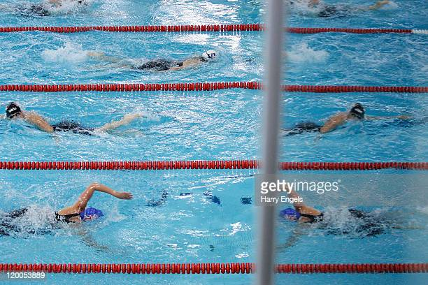 Contestants take part in the swimming event during the women's semi final round of the modern pentathlon European Championships at Medway Park on...