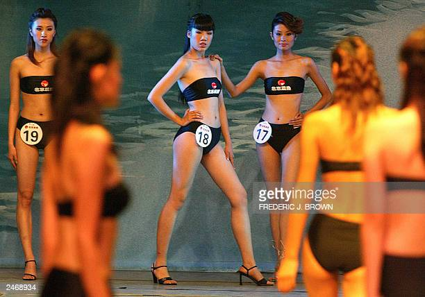 Contestants wait their turn to walk the catwalk during the Beijingleg of the New Silk Road modelling contest 06 September 2003 Thirty winners...