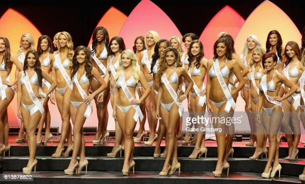 Contestants wait to find out who is chosen to be a top 10 finalist during the 21st annual Hooters International Swimsuit Pageant at The Pearl concert...
