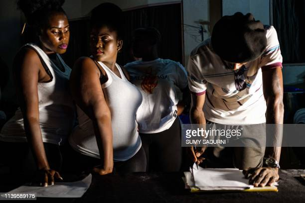 Contestants wait to register for the first edition of Miss Curvy Uganda in Kampala Uganda on April 26 2019 The pageant aims to celebrate African...