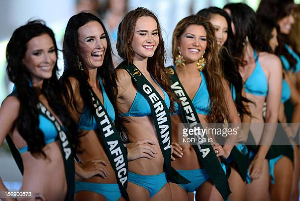 Contestants wearing swimsuits pose during the 2012 Miss Earth competition in Manila on November 24 2012 Around 91 contestants from around the globe...
