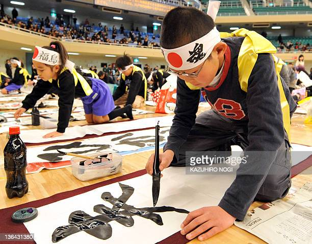 Contestents write calligraphy during the 48th annual New Year calligraphy contest in Tokyo on January 5 2012 Nearly 3000 people participated in the...