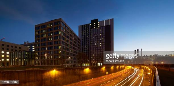 Contextual view with city bypass at dusk Leeds Central Village Leeds United Kingdom Architect John McAslan Partners 2015