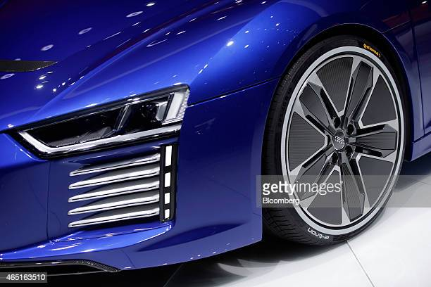 A Continental AG tyre sits on the alloy wheel of an Audi R8 etron electric automobile produced by Audi AG as it stands on display on the opening day...