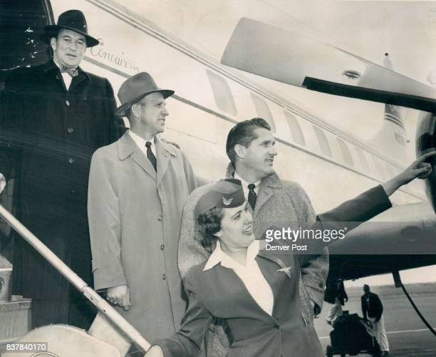 Continental Air Lines Stewardess Lyn Rabon points out the scenic beauty of Denver's nearby mountains to Harry Craft Kansas City Athletics coach Enos...