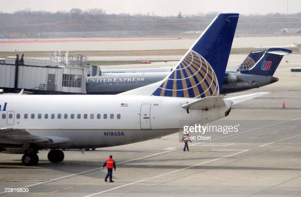 Continental Airlines jet prepares to leave a gate where it was loaded next to a United Airlines jet at O'Hare Airport December 13 2006 in Chicago...