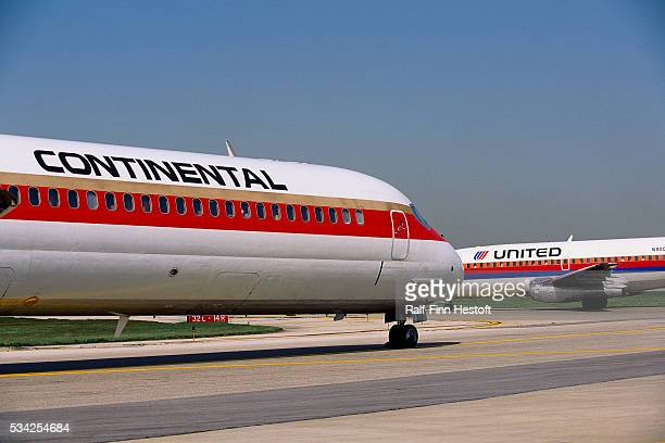 Continental and United airplanes on runway at Chicago O'Hare International Airport | Location Near Chicago Illinois USA