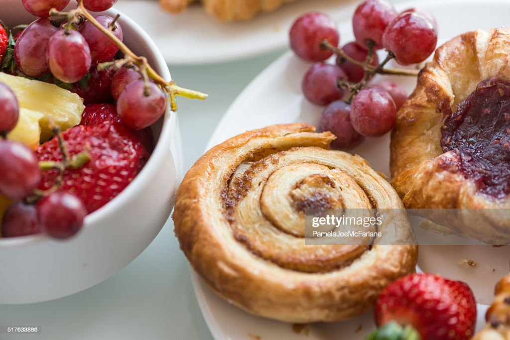 Continental Breakfast Buffet, Fresh Fruit, Cinnamon Bun and Danish Pastries : Stock Photo