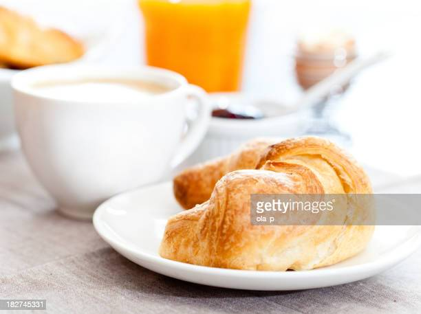 Continental breakfast of coffee and a croissant