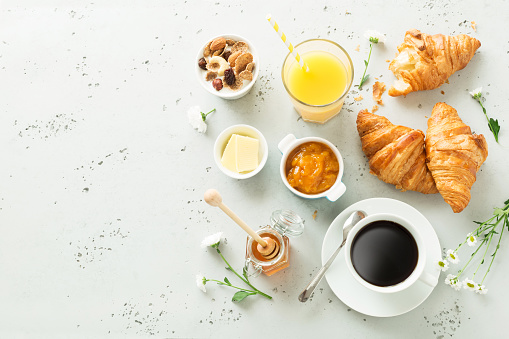 Continental breakfast on stone table from above - flat lay 1131097081
