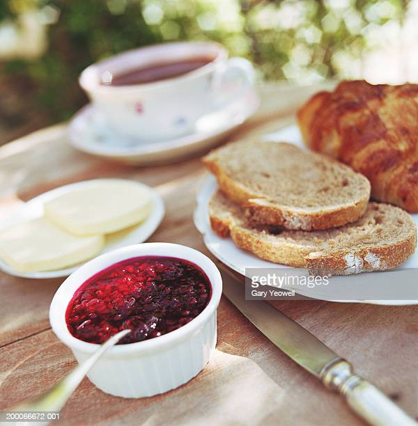 Continental breakfast on table outdoors, close-up