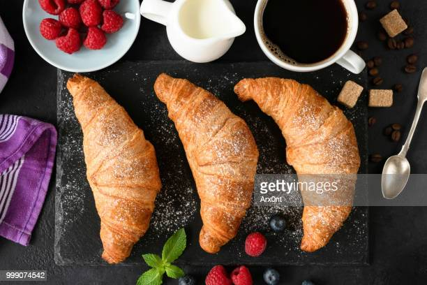 Continental breakfast with croissants, coffee, cream and berries