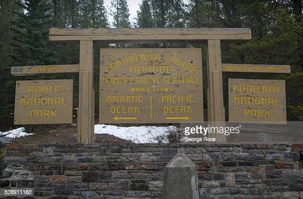 Continental Divide sign in Kootenay National Park is viewed on April 26 2016 at Vermillion Pass Alberta Canada Kootenay National Park borders Banff...