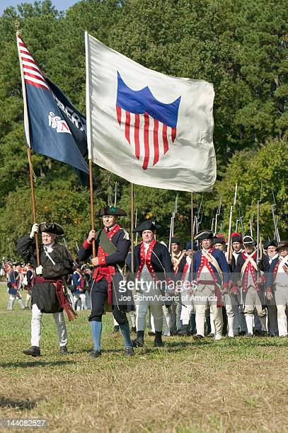 Continentals on the march with early American Flags in reenactment of Attack on Redoubts 9 10 where the major infantry action of the siege of...