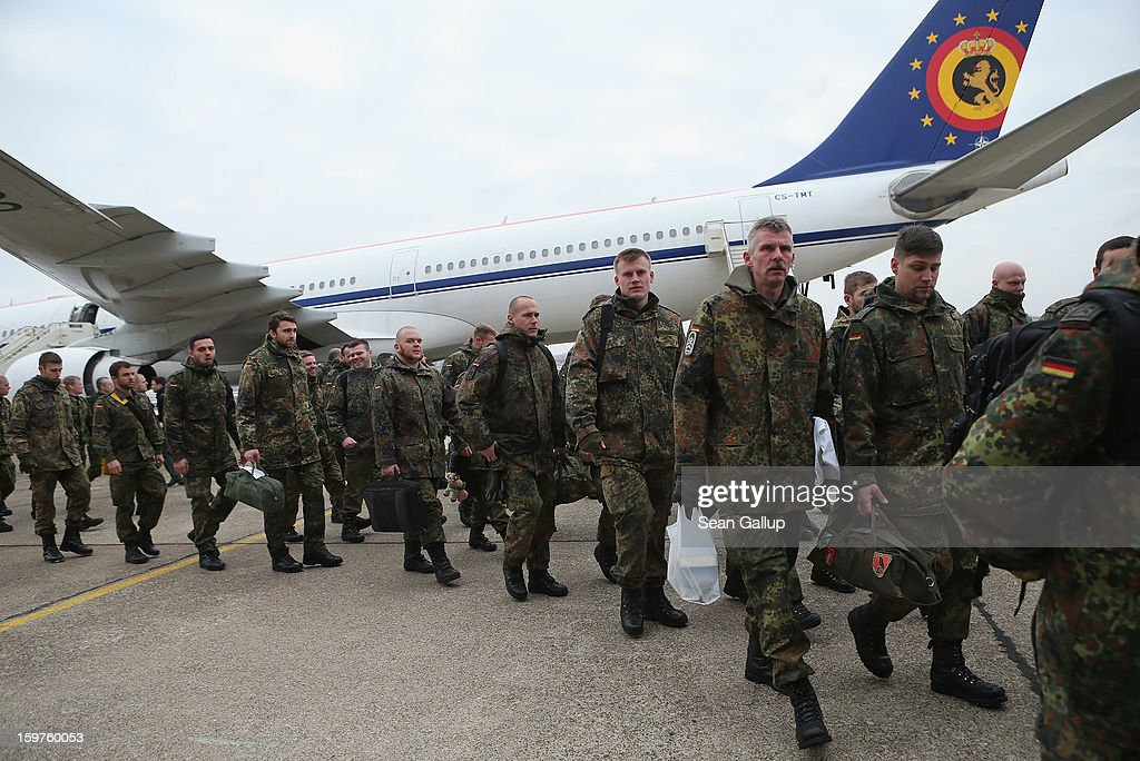 A contingent of approximately 240 soldiers of the German Bundeswehr arrive to board a plane for Turkey on January 20, 2013 in Berlin, Germany. German is committing two units of Patriot anti-missile systems to help defend Turkey from possible attack from Syria.