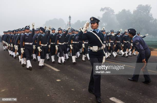 a contingent of indian air force led by a female commander marches in new delhi. - indian air force stock-fotos und bilder