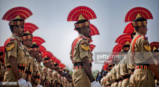 A contingent of Indian paramilitary troopers stand in formation before their parade at Bakshi Stadium where the authorities hold the main function...
