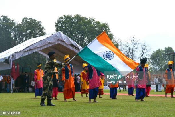 A contingent of Indian police men march during the Indians 72nd Independence Day celebration at ShereKashmir Stadium in Srinagar the summer capital...