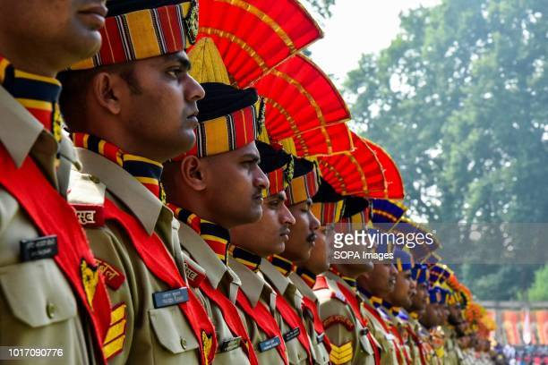A contingent of Indian policemen stand in formation at the ShereKashmir stadium where the authorities hold the main function during India's...
