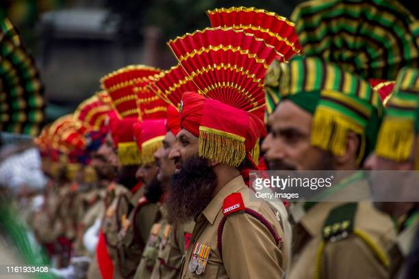 A contingent of Indian policemen stand in formation before their parade at the Sher i Kashmir stadium where the authorities held the main function...