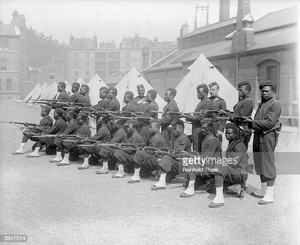 A contingent of local constabulary from the Gold Coast region of West Africa at Chelsea Barracks in London June 1897 The 22 men and two officers are...