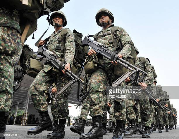 A contingent of Philippine marines march during a sendoff ceremony at the navy headquarters in Manila on July 3 2009 where they will be deployed to...