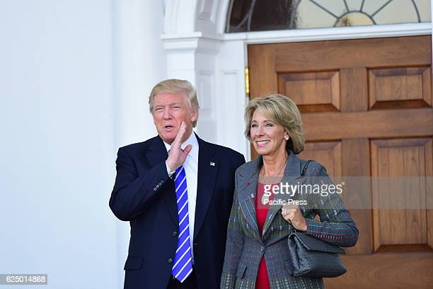 Continuing a day of oneonone meetings with candidates for positions in his cabinet Presidentelect Donald Trump met with Betsy DeVos two polar...