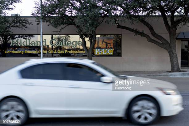 Continuing education for oil and gas professionals is advertised in the window of Midland College in downtown Midland Texas US on Thursday March 1...