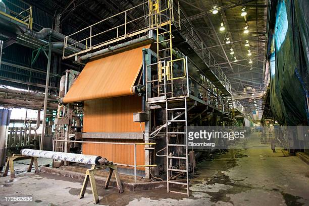 A continuous belt collects paper fiber and turns it into new rolls of paperboard on the paper mill at Newark Recycled Paperboard Solutions in...